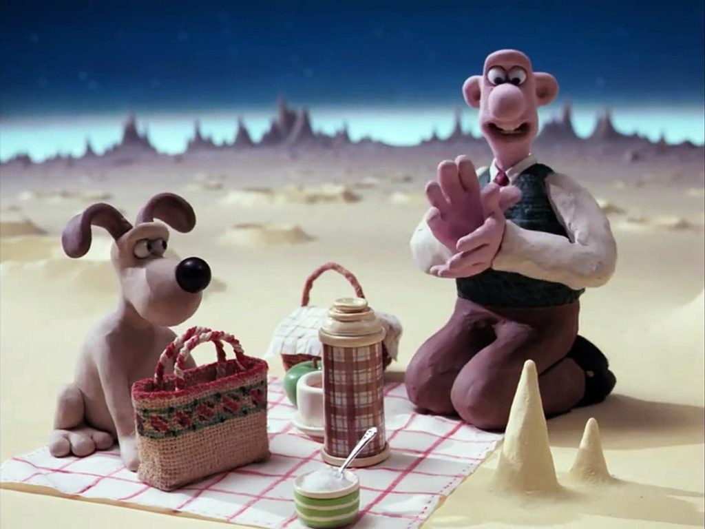 Wallace and Gromit about to enjoy some cheese on the Moon.